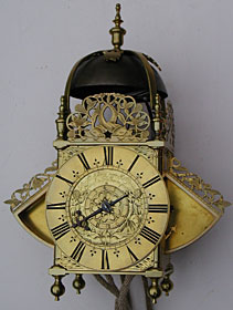 Winged lantern clock made in the 1670s by Richard Ames of London