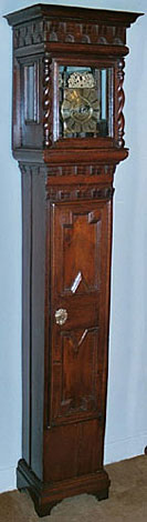 A newly-discovered lantern clock in its original oak standing case of a particularly distinctive type, dating from the late 1680s, signed          simply by monogram BH