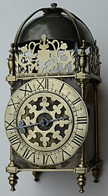 rare Charles I period lantern clock having a fretted centre