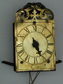 tiny single-handed hook-and-spike wall clock made in 1762 by Simon Douta