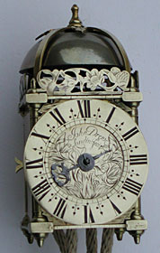 Tiny miniature striking lantern clock made in the 1680s by John Drew of London