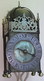 primitive lantern clock with iron frame dating from the early seventeenth century