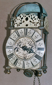 Seventeenth century lantern clock in its original case