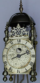 Exceptionally rare English lantern clock, made about 1630 having a moon dial
