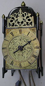 primitive iron-framed lantern clock made about 1660