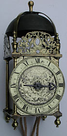 Unsigned Charles II period lantern clock (1660s) on a modern oak hooded bracket