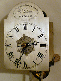 A miniature weight-driven hanging wall alarm clock made about 1800 by Mark Salmoni of Oxford