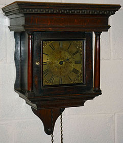 Tiny hooded wall clock made in the 1760s by George Wood of Nailsworth