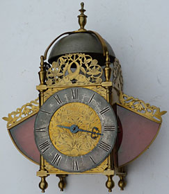 Lantern clock with glazed wings, original verge escapement and short pendulum between the trains, made in the 1690s by John Wright of Mansfield, Nottinghamshire